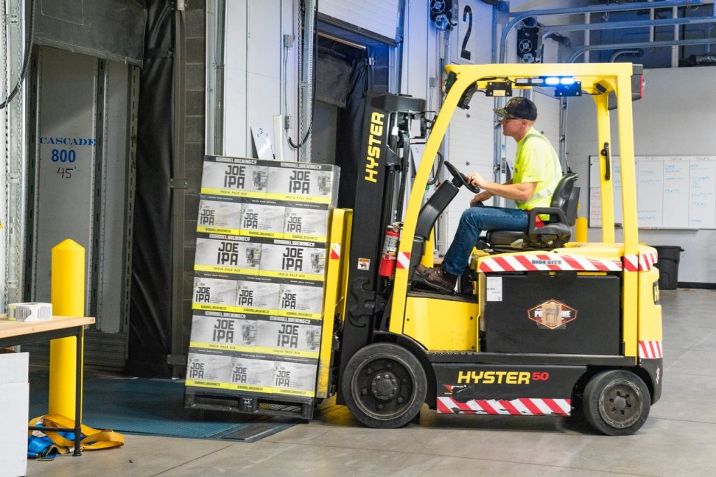 man working with a forklift